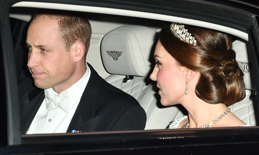 Prince William and Kate arrived at Buckingham Palace's annual Diplomatic Reception together on December 5 - William in a handsome tuxedo and Kate in a white gown, tiara, and diamonds and pearls galore.