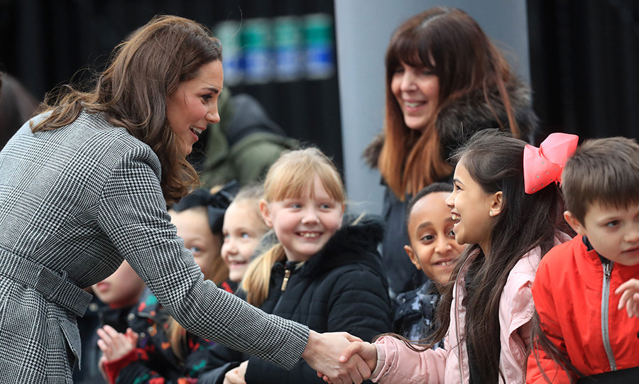 The Duchess of Cambridge meets children as she arrives for the Children's Global Media Summit at Manchester Central Convention Complex.