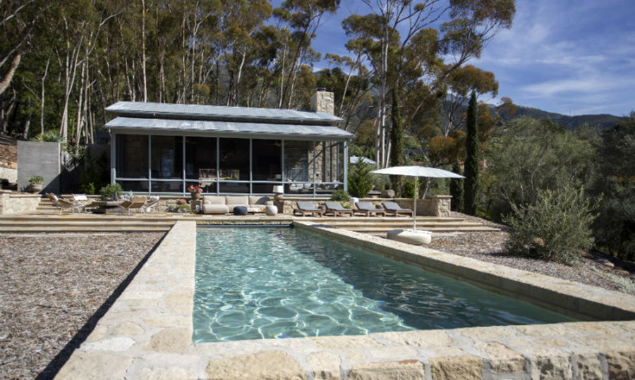 <p>The luxurious property boasts an outdoor swimming pool overlooking a stunning landscape. There are a number of sun loungers alongside the pool, along with an al fresco dining area where Portia and Ellen can relax.</p>