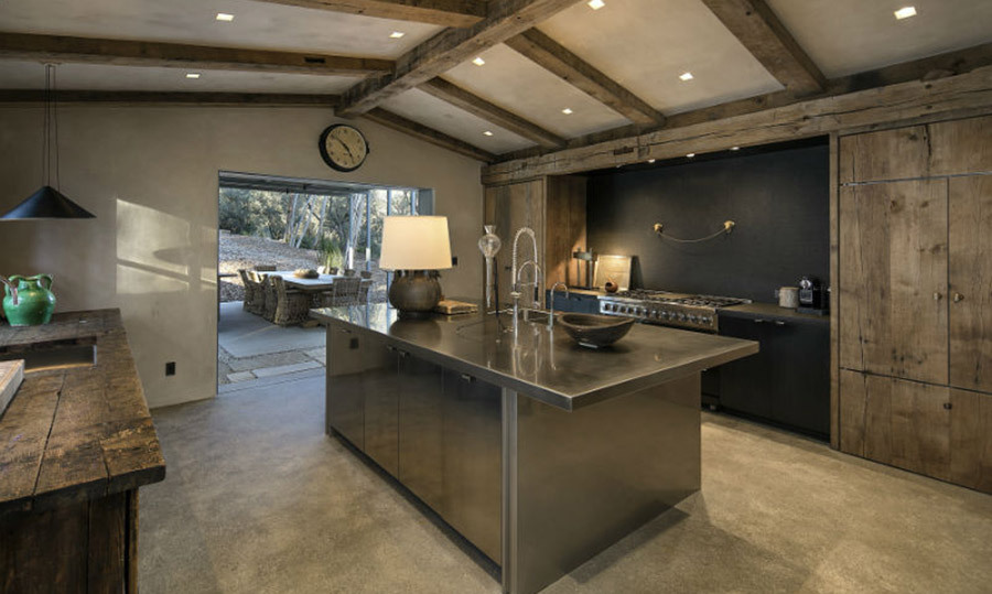"<p>Ellen describes her property as: ""A home that manages to be both spacious and cosy at once"", and we definitely agree! We love the industrial feel of her kitchen, with a stainless steel island and wooden cabinets.</p>