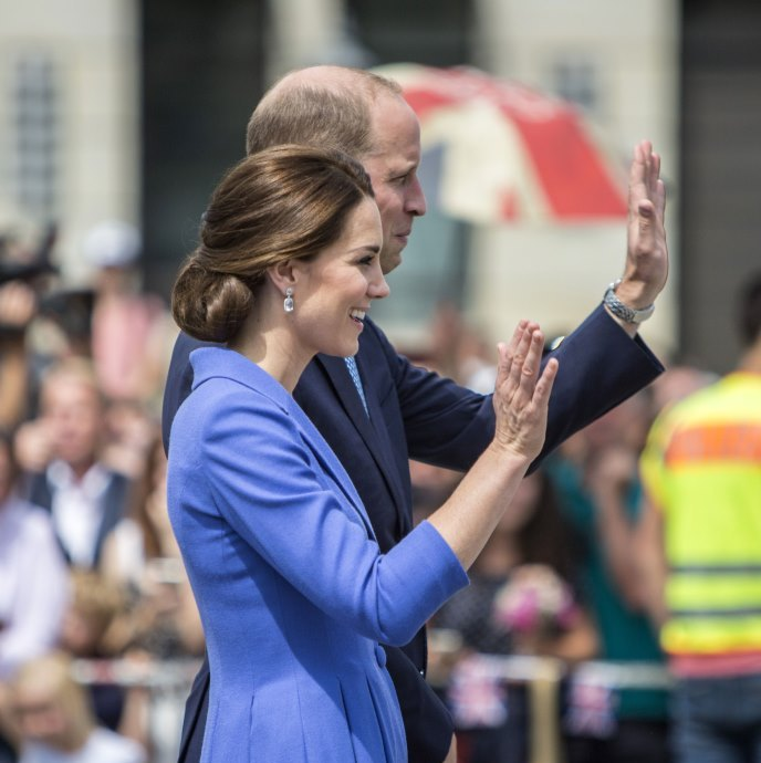 <p>With an off-centre parting, the Duchess of Cambridge looked simply stunning on this July visit to the Brandenburg Gate in Berlin. The low chignon showed off her delicate features and gave her a very respectable look on her visit to Germany.</p>