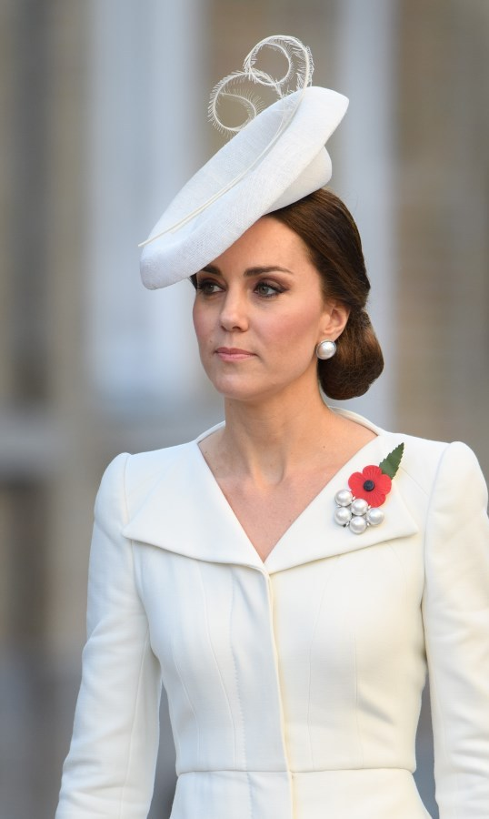 <p>Mention must be given to this style which you can see briefly showing underneath her white hat. Another low chignon, the Duchess of Cambridge oozed chicness in July at the 100th Anniversary of Passchendaele - Third Battle of Ypres in Belgium.</p>