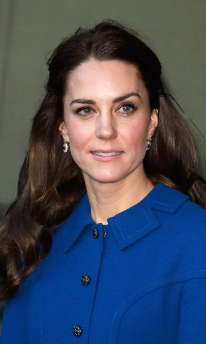 <p>At a visit in January to the Anna Freud Centre in London, the Duchess wore her hair in a chic and very feminine style, half pinned up at the sides. Her long flowing hair looked absolutely stunning and pinned back off her face showed off her elegant earrings.</p>