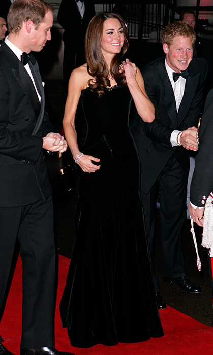 <p>Joined by husband Prince William and brother-in-law Prince Harry, the Duchess of Cambridge was stunning in a sumptuous strapless black velvet Alexander McQueen gown at an awards ceremony at the Imperial War Museum in December 2011.</p>