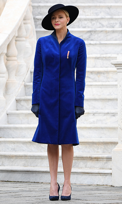 <p>During Monaco National Day in November 2017, Princess Charlene of Monaco donned a bespoke coat in cobalt blue velvet by one of her favorite labels, Akris. She finished off the look with a wide-brimmed hat and dark blue shoes and leather gloves.&nbsp;</p>