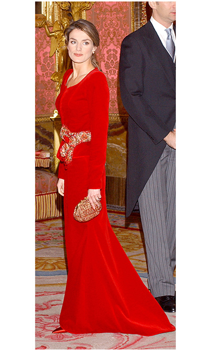 <p>Talk about a lady in red! While she was crown princess, Queen Letizia of Spain showed she was ready for the most regal of looks in red velvet. The royal wore the jacket and skirt combination to receive ambassadors at the Royal Palace in Madrid back in 2005.</p>