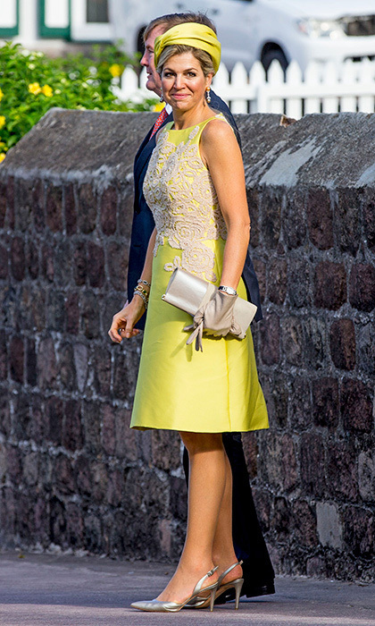 During a visit to the Caribbean, Queen Maxima of the Netherlands wore a bright lemon-lime lace-embellished dress by Natan. The monarch's wife also wore metallic slingback sandals and a citrus-hued silk turban for the occasion – the annual celebration of Saba Day on the island of Saba.