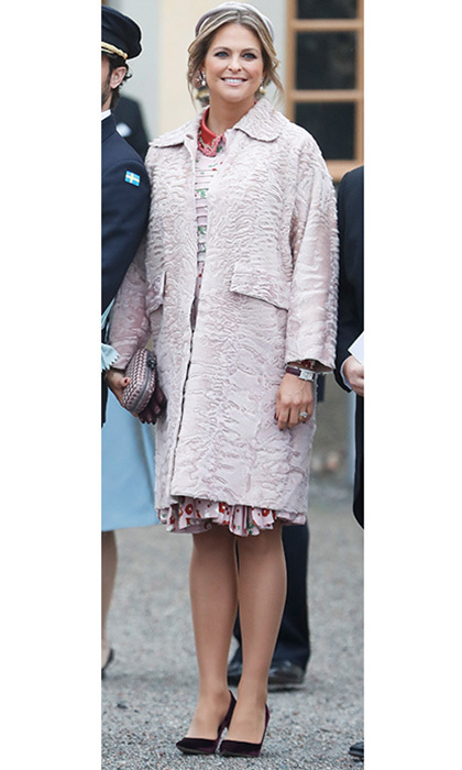 Serving as godmother to her nephew Prince Gabriel at the baby's royal christening, Princess Madeleine of Sweden wore a soft pink dress by Valentino along with a dusty rose coat and box clutch. 