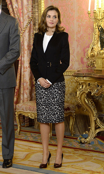 The Spanish queen added a wild touch to a daytime suit by teaming her belted jacket and white blouse with a leopard print skirt. Letizia was attending a meeting with members of the Princesa de Girona Foundation at the Royal Palace in Madrid on December 1.