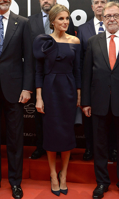 Queen Letizia of Spain wore designer Delpozo for the first time, choosing a dark blue off-the-shoulder look for the As sports newspaper 50th anniversary dinner at the Palacio de Cibeles in Madrid on December 4. The tailored dress, which the royal wore with matching heels, featured an architectural oversized rose detail on one shoulder. 