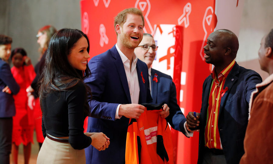<p>Harry laughed as he and his fiancée Meghan Markle were presented with a gift during their visit to the Nottingham Contemporary, which is where the Terrence Higgins Trust held the World AIDS Day fair. The pair were also shown a UK AIDS memorial quilt that was made by friends and lovers of those who passed from the disease. Harry is following in the footsteps of his mother, Princess Diana, in combating the stigma that surrounds the disease.</p>