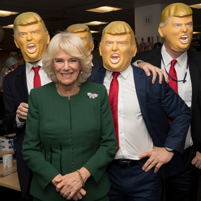 Camilla, Duchess of Cornwall laughed as she met staff and charity representatives dressed up as US President Donald Trump during the annual ICAP charity day at ICAP on December 5 in London. 
