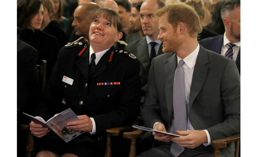 'Tis the season! Prince Harry sat next to London Fire Brigade Commissioner Danny Cotton during the organization's carol service on December 4 at Westminster Cathedral. After the event, where his ex Cressida Bonas was present, the newly engaged Prince met with frontline staff, firefighters and cadets.