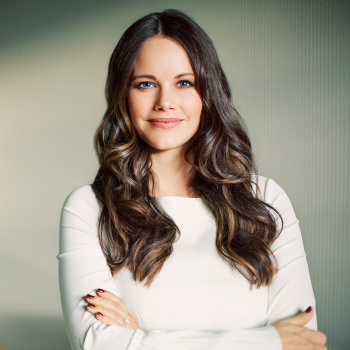Happy Birthday Princess Sofia! The Swedish Royal Court celebrated Prince Carl Philip's wife's 33rd birthday on December 6 with a new portrait. Prince Alexander and Prince Gabriel's mother looked regal for the glamour shot wearing a white ensemble, while her curled dark tresses were styled down.