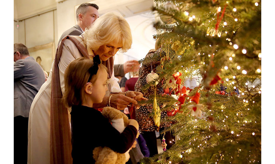 <p>Camilla decorating her Christmas tree at Clarence House.</p>