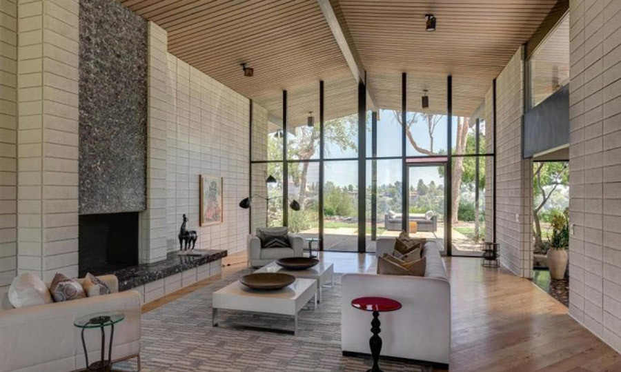 <p>Meryl's new living room has a touch of Japanese inspiration, with original terrazzo floors, high ceilings and glass walls overlooking the expansive and private gardens. It is currently furnished with a cream sofa and armchairs positioned around a traditional fireplace.</p><p>Photos courtesy of Trulia</p>