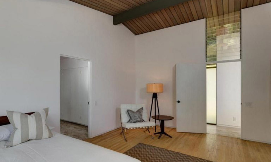 <p>There are three bedrooms in the property, including this room which is the perfect blank canvas for Meryl to put her own stamp on once she moves in. It has white walls and wooden flooring, with a double bed and armchair, along with its own en suite bathroom.</p><p>Photos courtesy of Trulia</p>