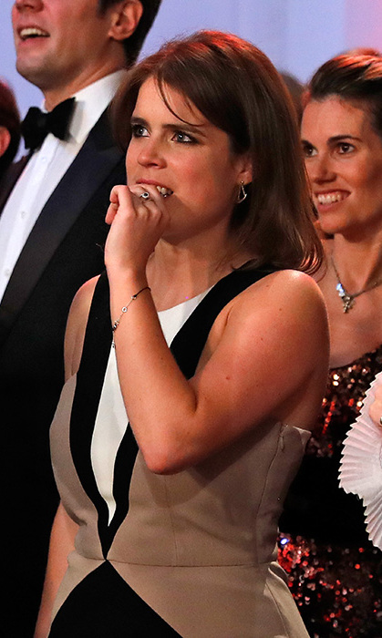 <p>Princess Eugenie dazzles while raising money at black tie charity event.</p>