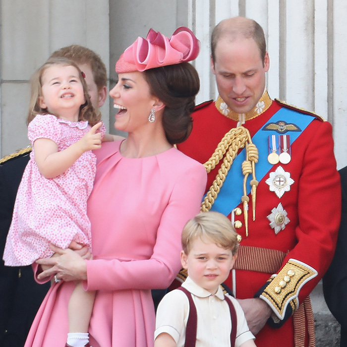 The Duchess of Cambridge and her adorable daughter Princess Charlotte shared a sweet moment during Trooping of the Colour festivities on June 17. Equally as cute were their matching dresses as they watched the show from the balcony at Buckingham Palace!