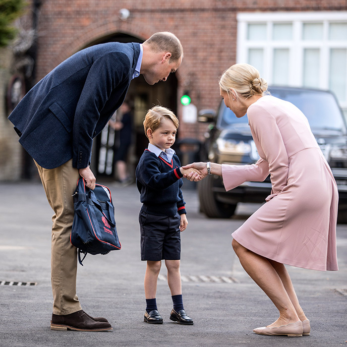 A nervous Prince George greeted his new teacher on his first day of classes at Thomas's Battersea lower school. 