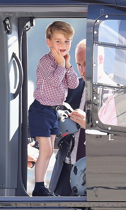 Prince George could hardly contain his excitement as he explored a helicopter at Hamburg airport on July 21. The little royal loves planes and helicopters, just like his dad Prince William and uncle Prince Harry. 