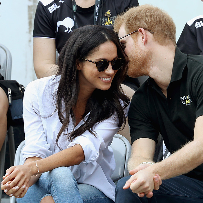 Two months before announcing their engagement, Prince Harry and Meghan Markle made their first official, and PDA-filled, appearance together at the Invictus Games in Toronto. 