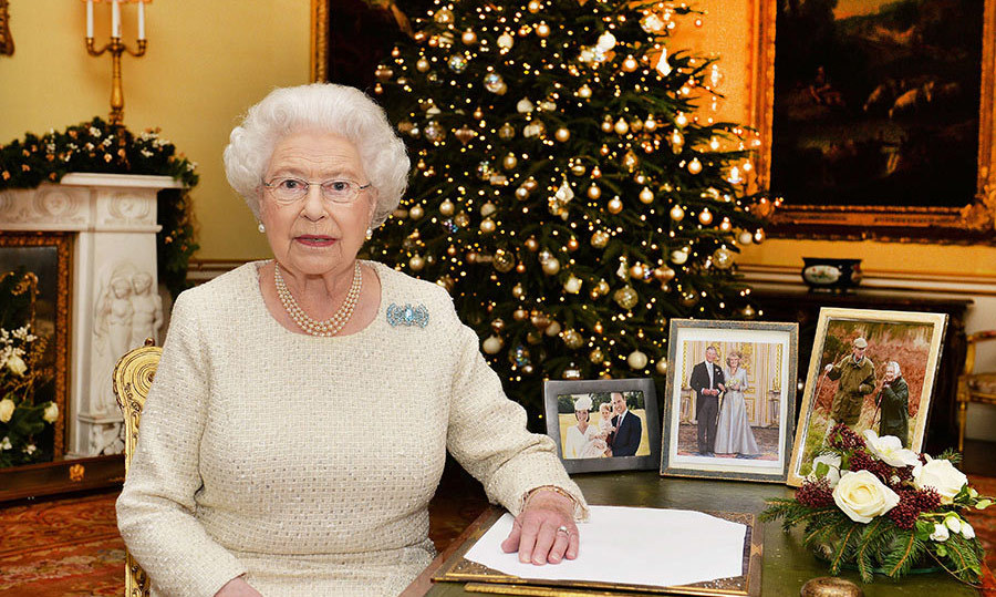 <p>The 18th Century Room was the location for the 2015 Christmas message, and was decorated with neutral and gold Christmas decorations to complement the colour scheme of the room. A floral garland lies on top of the fireplace in the background, while some of Her Majesty's precious family photos sit next to her on the desk, including a portrait from Princess Charlotte's christening.</p>