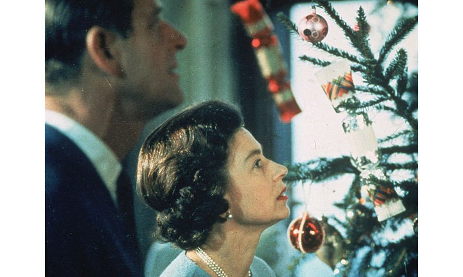 <p>No Christmas broadcast took place in 1969, however viewers were still given a glimpse inside Buckingham Palace with the documentary, <em>Royal Family</em>, which was repeated on Christmas Day. Here, the Queen and Prince Philip can be seen looking at their tree, which is decorated with red baubles and traditional paper crackers.</p>