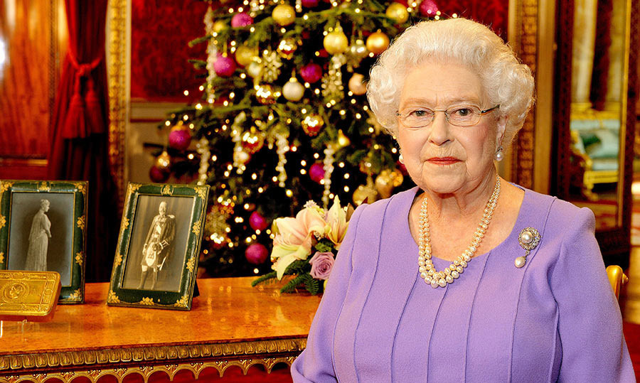 <p>It was a merry and bright Christmas with the magnificent backdrop of the State Dining Room for the Queen's broadcast in 2014. Although this room has a vibrant red and gold colour scheme, staff opted for a striking colour clash with the decorations, adding pink baubles to the Christmas tree. For this year the Queen paid tribute to her grandfather King George V and Queen Mary by presenting their portraits on the table alongside a decorated brass tin given to all members of the British, Colonial and Indian Armed Forces for Christmas 1914.</p>