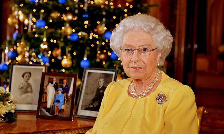 <p>The Blue Drawing Room was chosen for 2013's Christmas message, and there was a colour scheme to match. Vibrant cobalt baubles hang from the tree, adding a pop of colour to the otherwise classic gold decorations. Portraits of her mother and father stand on the table alongside an official photo taken from Prince George's christening earlier that year.</p>