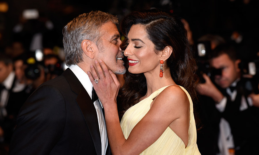 "<h4>BABY DADDY</h4><p>Hello! celebrated with George and Amal Clooney as they welcomed twins on June 6. ""Ella, Alexander and Amal are all healthy, happy and doing fine,"" said the star's rep. While the twins haven't been seen in public, he has opened up about being a dad. ""It was a horror film!"" he joked of changing the infants' diapers.</p><p>Photo: &copy; Getty Images</p>"