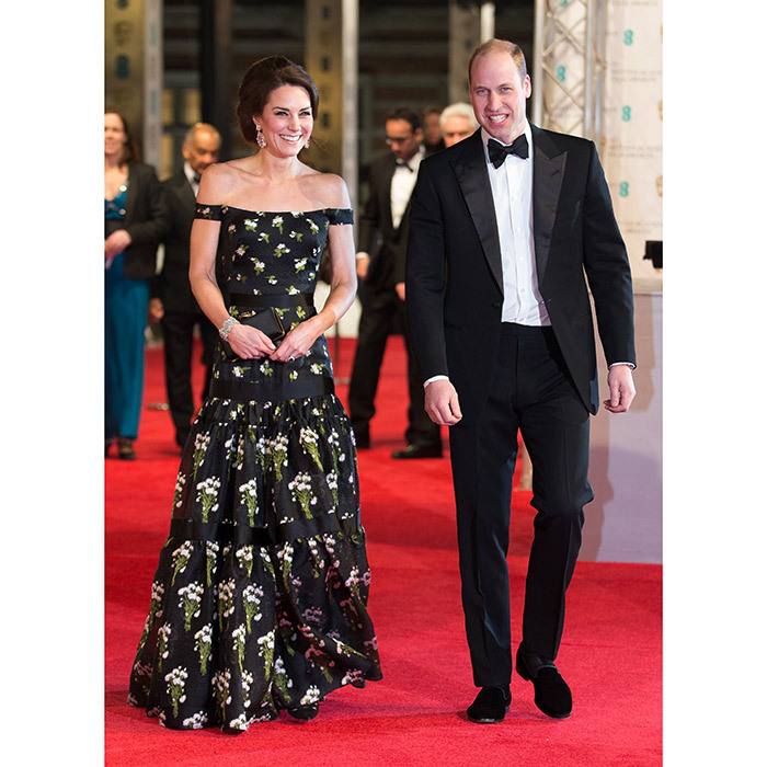 <h4>DATE NIGHT</h4><p>Exuding their own movie-star glamour, the Duke and Duchess of Cambridge made a dramatic entrance at the 70th British Academy Film Awards (the BAFTAs). Kate turned heads in an off-the-shoulder black Alexander McQueen gown embellished with white flowers, while a dapper William wore a tux. </p>