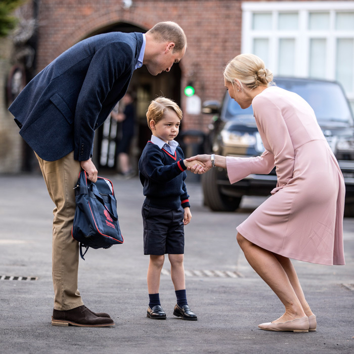 For his first day of Thomas Battersea on September 7, 2017, Prince George was accompanied by his dad Prince William. The four-year-old royal looked adorable in his school uniform and said hello to Head of Lower School, Helen Haslem. The school administrator shook the royal pupil's hand before strolling with the pair inside. William joined his son at his reception classroom.