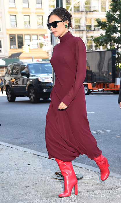 <p>We love this burgundy dress and red boot combination. Victoria wore the chic outfit while out in New York in October.</p>