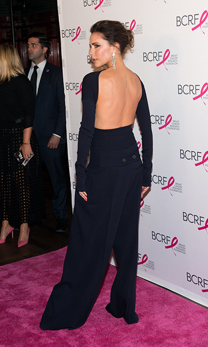 <p>This may be Victoria's best look of the year! The former singer donned a sophisticated black catsuit with open back from the <em>Breast Cancer Research Foundation Hot Pink Party</em> at Park Avenue Armory in New York in May. Her glitzy drop earrings are to die for.</p>