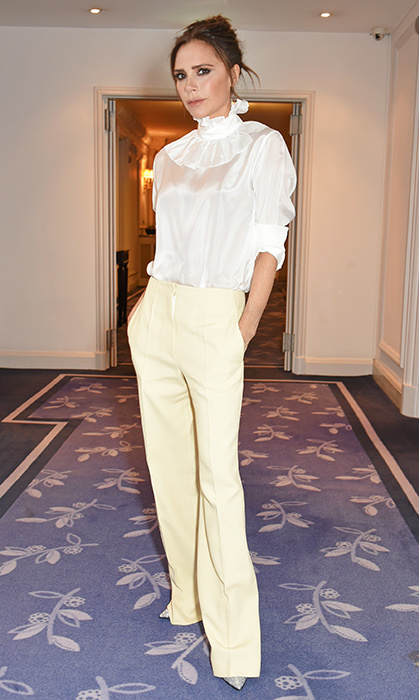 <p>In November, Victoria opted for a Victorian style high-necked blouse and canary yellow trousers for the <em>Harper's Bazaar Women of the Year</em> at Claridge's Hotel in London.</p>