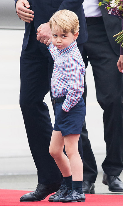 <p>Another smart look for Prince George! The young royal wore the red, white and blue checked shirt for a royal visit in Warsaw with his family in July. We love his cute expression!</p>