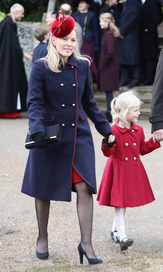 Also joining the royals for the traditional December 25 church service was Queen Elizabeth's Canada-born granddaughter-in-law Autumn Phillips, who wore a double breasted military style wool coat in navy blue. Her hat and the red piping on her coat perfectly complemented daughter Isla's pretty red look.