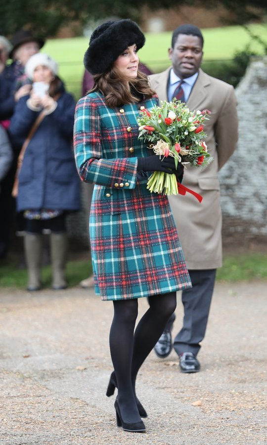 Double-breasted coats are definitely a royal trend! The Duchess of Cambridge wore a style by Miu Miu in festive green and red tartan. 