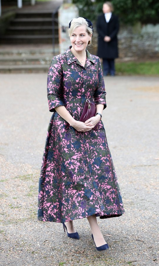 Prince Edward's wife also attended the St Mary Magdalene church service in style. Sophie Wessex opted for a retro look in a 1950s style pink and blue dress, worn with jewel-toned accessories – pumps and a hat in deep blue, and a purple leather clutch with tassel detail.