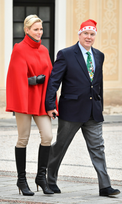 Santa baby! Princess Charlene and Prince Albert II of Monaco knocked holiday style out of the park at their annual children's Christmas ceremony at the Monaco palace. The royal couple rolled out looking festive from head-to-toe at the December 20 event for kids. Charlene, 39, kept things simple in a cheery red cape while her husband, 59, opted for a Christmas tie and Santa hat!
