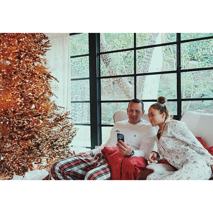Jennifer Lopez and Alex Rodriguez cuddled close in their pajamas as the All I Have singer's sister Lynda snapped the candid shot. The couple spent their first Christmas together in Miami with family.
