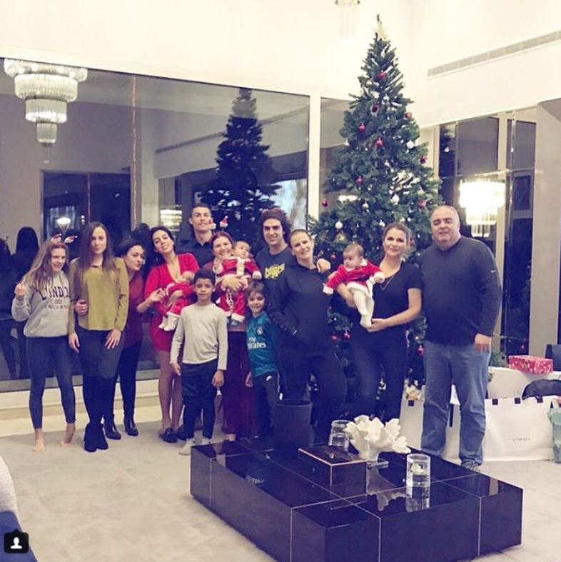 Cristiano Ronaldo's family surrounded the Christmas tree for his first holiday as a dad of four. In the shot, his love Georgina Rodriguez held their youngest addition to the family, their daughter Alana.