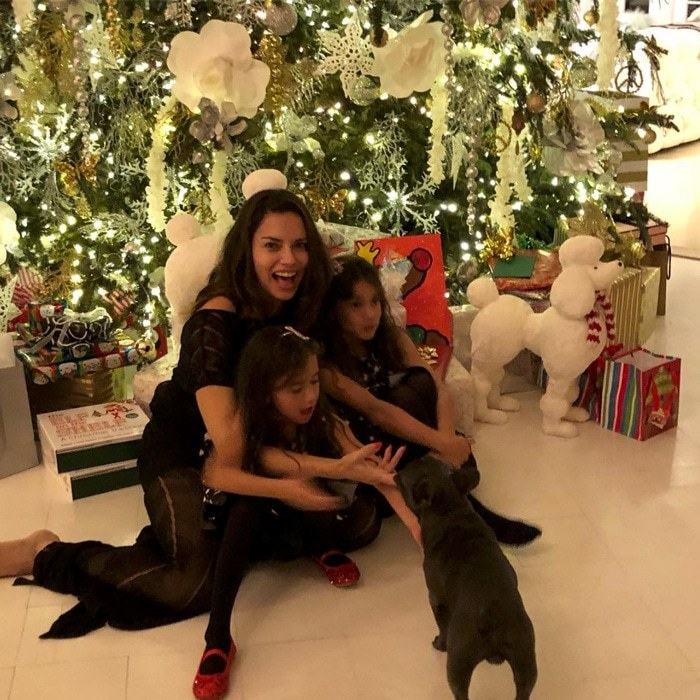 "Victoria's Secret model Adriana Lima had the best presents under the tree — her daughters Valentina and Sienna Jarić! ""MERRY CHRISTMAS FROM THE LIMA FAMILY ,"" the model captioned the holiday picture.