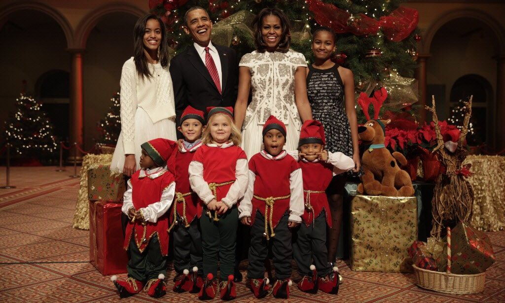 "Barack, Michelle, Malia and Sasha Obama were joined by elves for a holiday portrait shared by the former president on Christmas Day. Alongside the picture, the dad-of-two wrote, ""On behalf of the Obama family, Merry Christmas! We wish you joy and peace this holiday season.""