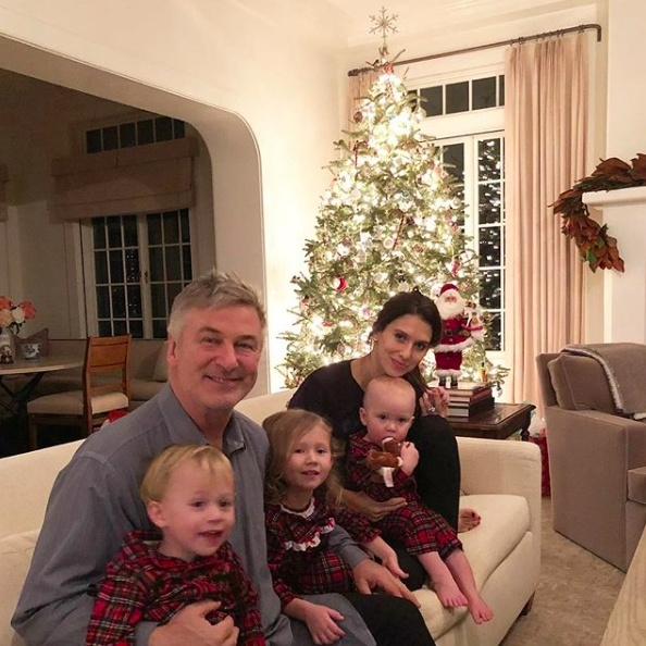 "Hilaria Baldwin shared an adorable snap of husband Alec and their three children celebrating the holidays! Next year, their family photo will have another Baldwin baby! She captioned the photo, ""Merry Christmas  ❤️!"" 