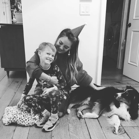 "Hilary Duff shared a photo of a sweet Christmas moment with her son Luca and her pup. The actress and singer captioned the photo, ""Merry Christmas!!!!!!!""