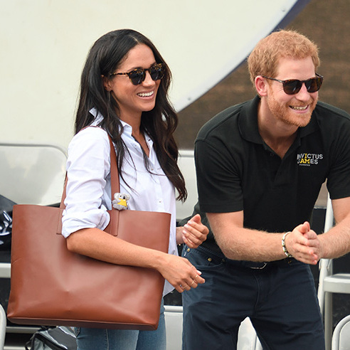When Meghan attended the Invictus Games in Toronto with then boyfriend Prince Harry, she wore a completely simple yet stunningly chic ensemble which consisted of well-cut jeans, a classic white shirt, smart pumps and of course, a fabulous tote bag. The tan Everlane Cognac tote is made from Italian leather and is a wide tote bag that would fit all Meghan's essentials in. The bag retails at around $220.