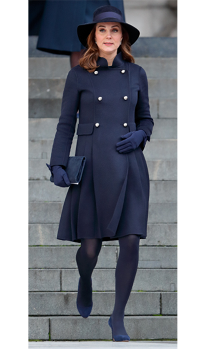 Duchess Kate attended a memorial service for the Grenfell Tower fire on Dec. 14. The sombre royal looked elegant in a navy Carolina Herrera coat, a wide-brimmed hat and navy suede Jimmy Choo heels.