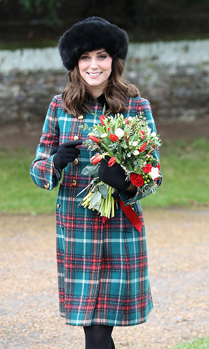 Kate looked fashionably festive as she stepped out for Christmas day with her royal family, including Meghan Markle! The Duchess wore an elegant double-breasted Miu Miu coat dress embellished with gold buttons. Paired with a black fur hat, gloves and tights, Kate was also spotted wearing a pair of Kiki McDonough Eden earrings for the occasion.